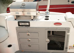 Fully equipped boat kitchen or galley on a white ski boat