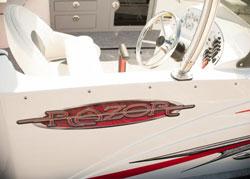 Driver's side of a white Razor boat