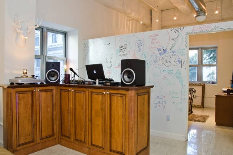 This space features dry erase walls and a music mixing studio!