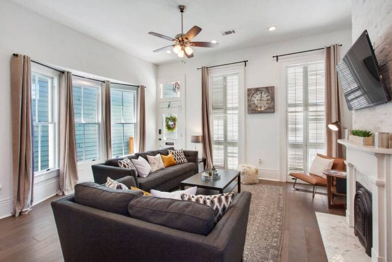 Airbnb New Orleans French Quarter This beautifully decorated living area is complete with two couches, fireplace and 55 inch television