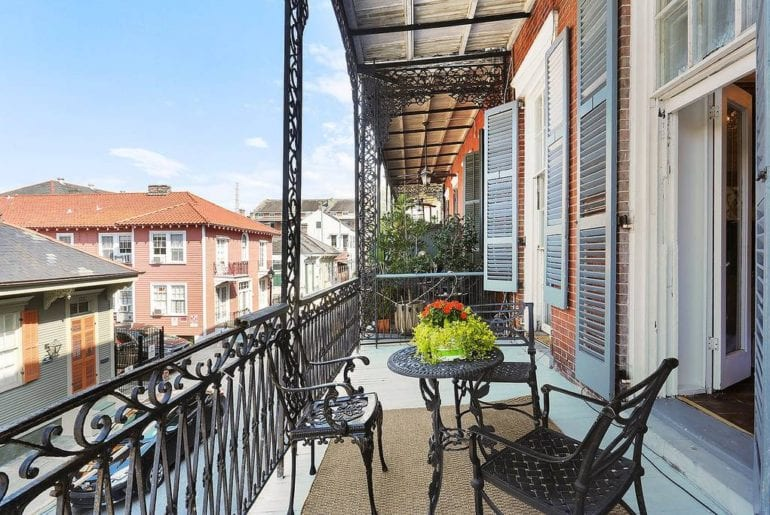 Airbnb New Orleans French Quarter Balcony seating with ample space for outdoor dining, or spectating the activities on Bourbon St.