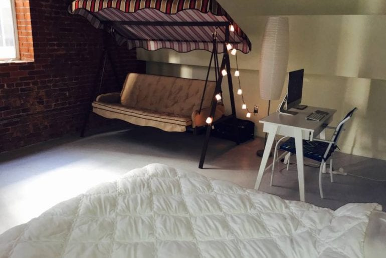 This room has a queen size mattress, your own private couch swing and desk with chair.