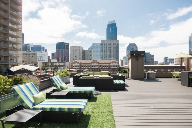 Seattle Pride Parade Turf lined rooftop with lounge chairs and BBQ grills.