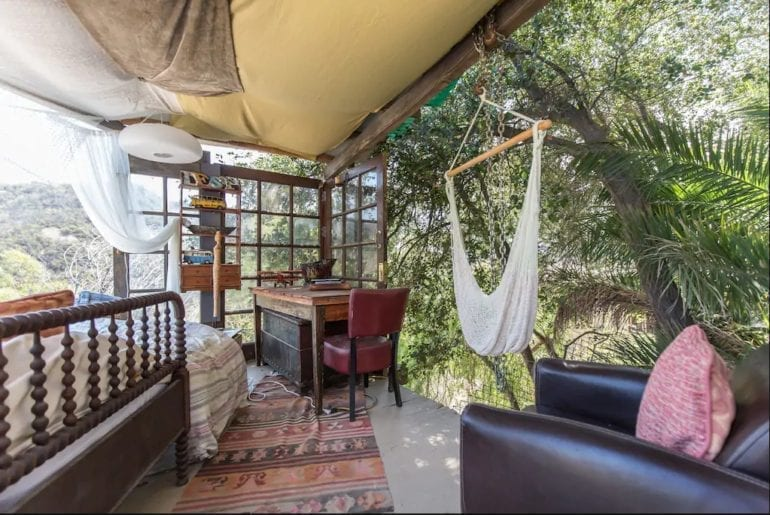Where to stay in Los Angeles: the bedroom has open walls and a cozy hammock to relax under the stars