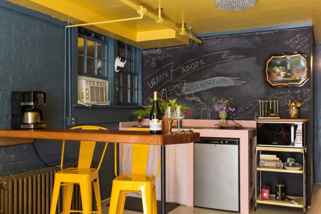 Funky and brightly colored apartment featuring a chalkboard wall