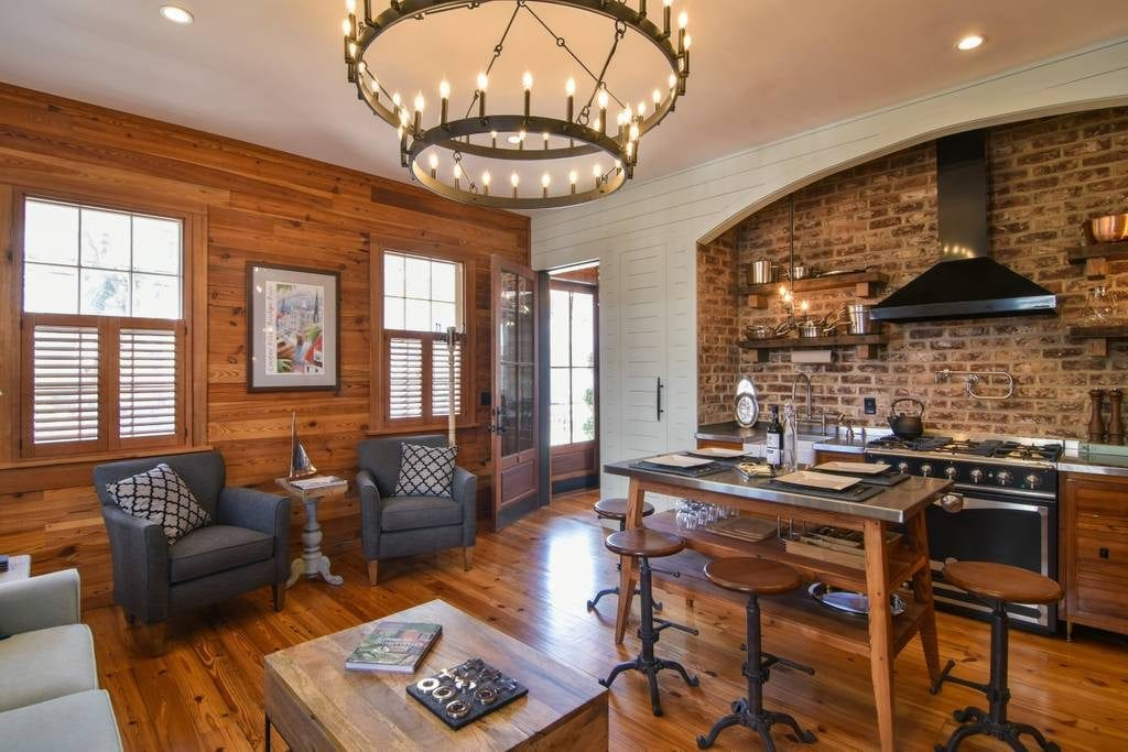 Reclaimed wood and exposed brick highlight the historical, colonial charm of this apartment