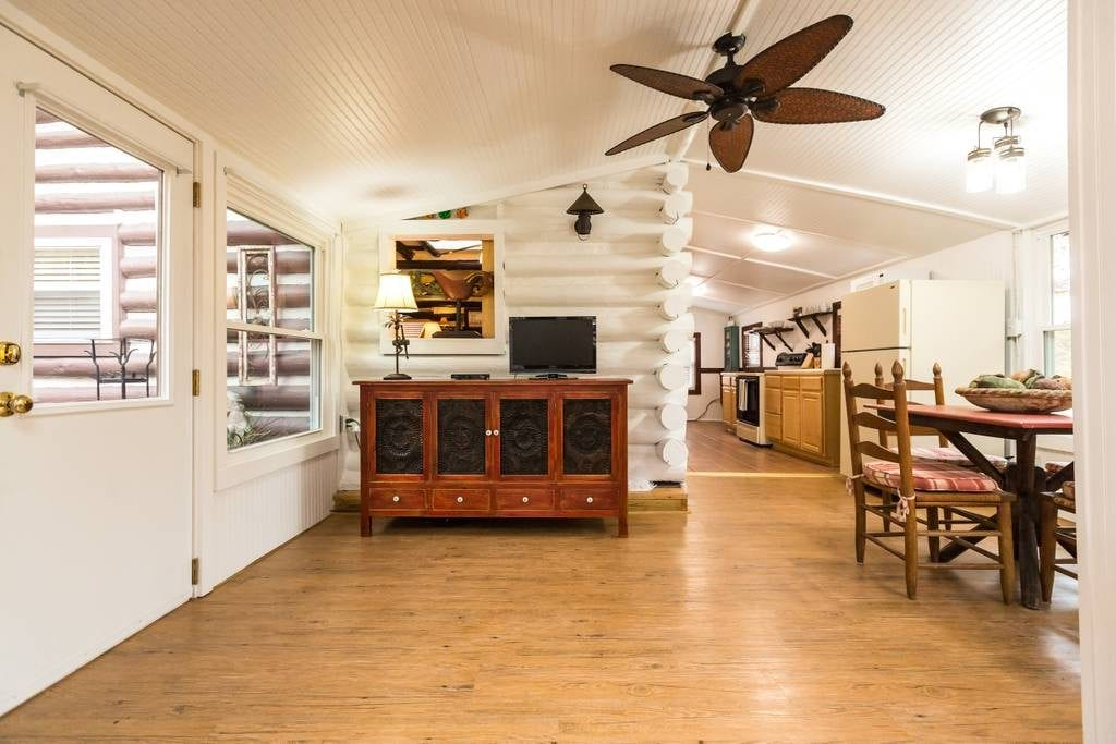 Bright and modern log cabin with ample timber-work features