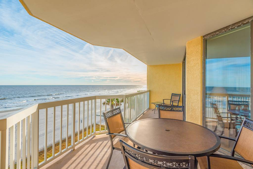 Covered patio gives this Folly Beach condo panoramic ocean views