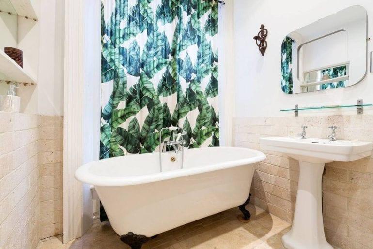 a stand alone bath tub in a kid friendly Airbnb