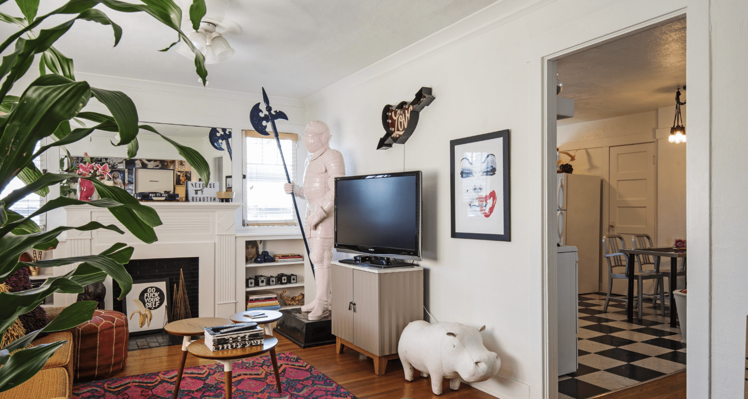 living area with a statue and a model hippo