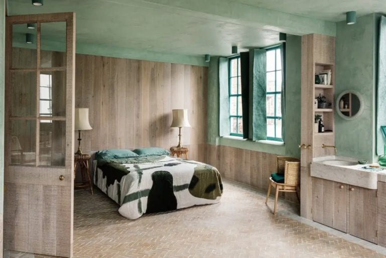 Wood panelled bedroom with lime green walls and ceiling
