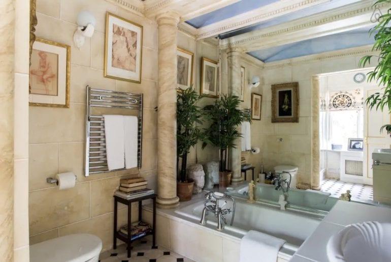 a bathroom with marble pillars in Kensington, London