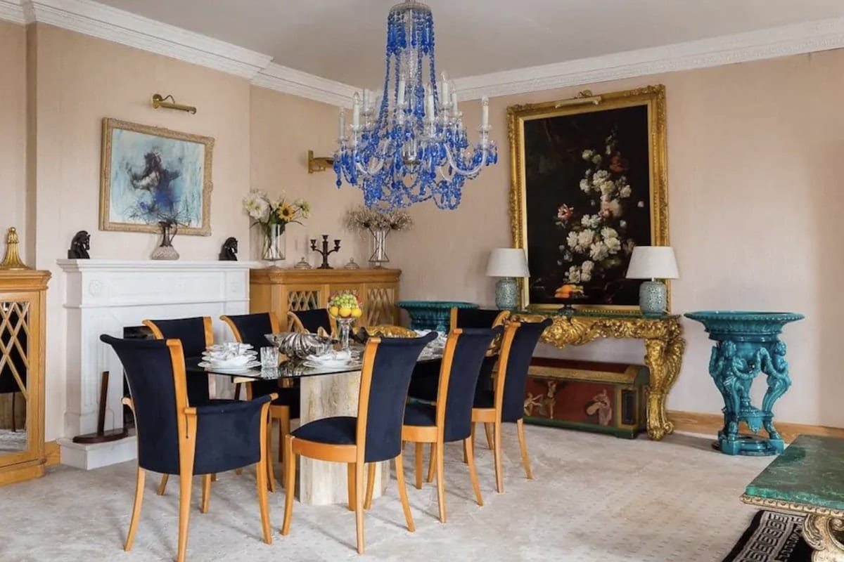 a hyde park Airbnb dining room with a chandelier and painting in the background