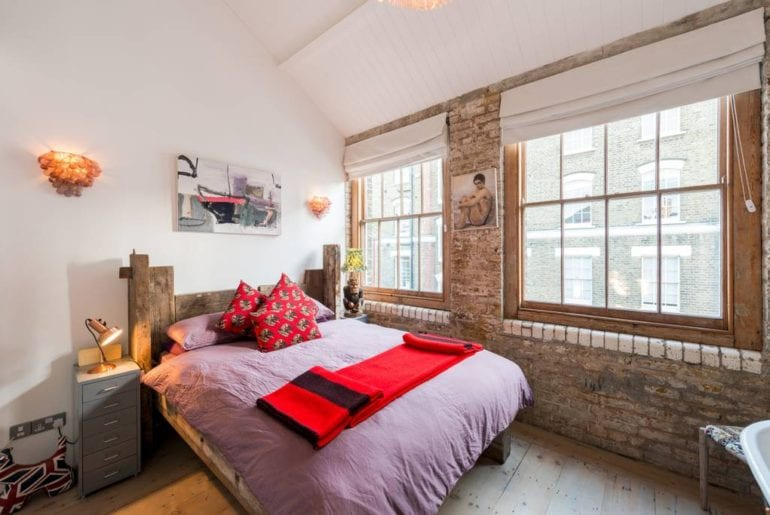 bedroom with bare brick walls in London Airbnb