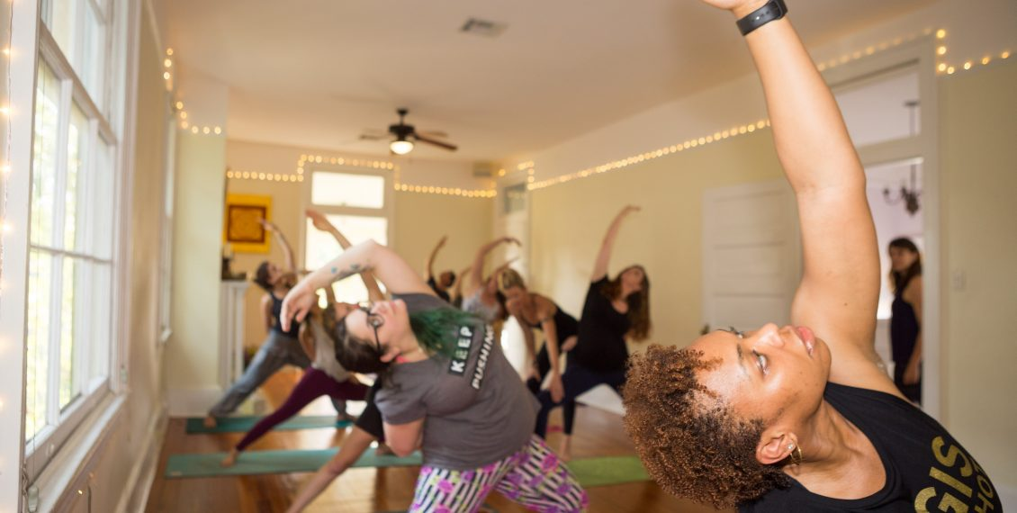 Diverse students practicing yoga