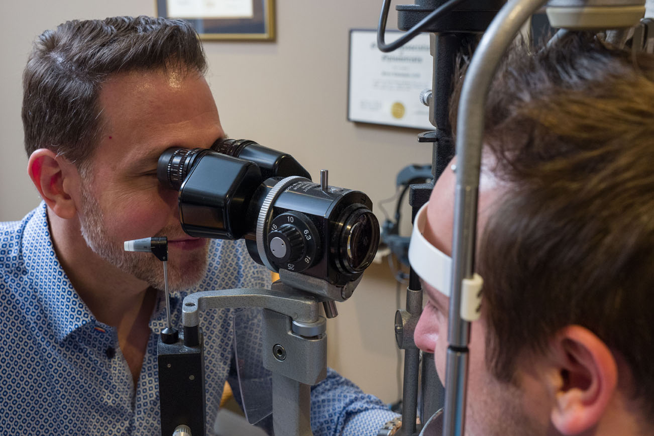 Dr Lawrence performing an eye exam
