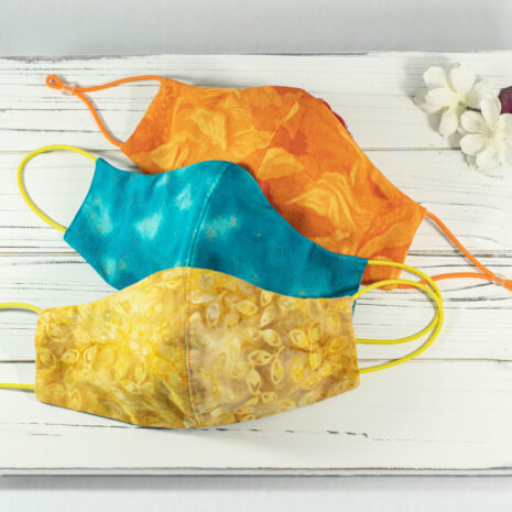 Classic Sculpted Cotton Face Mask Trio in Batik Yellow Leaves, Turquoise Sky, Sunflower