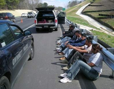 Eye on Immigrants: Following a traffic stop in Gwinnett County, Georgia, police detain 10 suspected illegal immigrants who were believed to be involved in a human-smuggling ring.