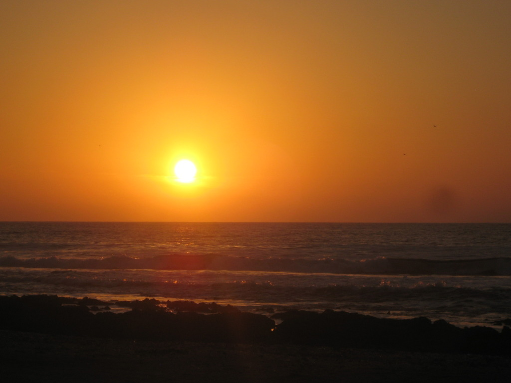 blazing orange sunset over Pacific ocean in chile