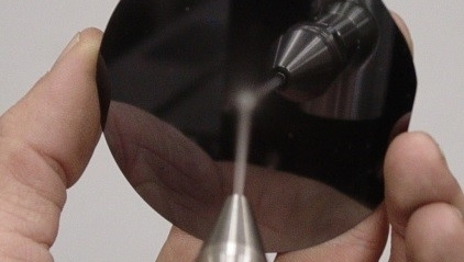 Particle Removal using CO2 Spray on Optical Surface