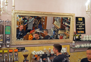 Waiting for a kopi luwak at the coffee bar in Florence, Italy