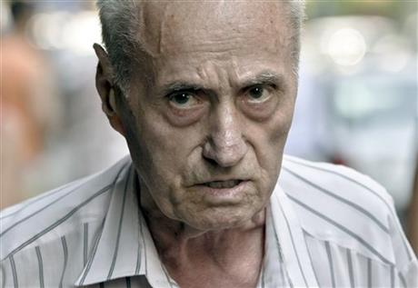EX PRISON GUARD CHARGED WITH GENOCIDE
