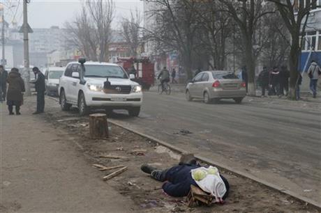 Rockets kill 21 in Ukraine city as rebel offensive begins