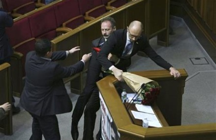 Scuffles erupt at Ukraine's parliament, PM dragged from post
