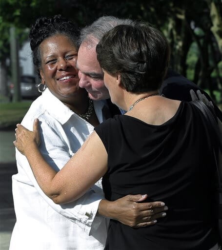 A fellow parishoner, left of St. Elizabeth's Catholic Church in Richmond, Va. greets Sen. Tim Kaine, center, and his wife, Anne Holton as they arrive for Mass St. Elizabeth Catholic Church, their longtime parish, his debut as Hillary Clinton's running mate, Sunday, July 24, 2016. (P. Kevin  Morley/Richmond Times-Dispatch via AP)
