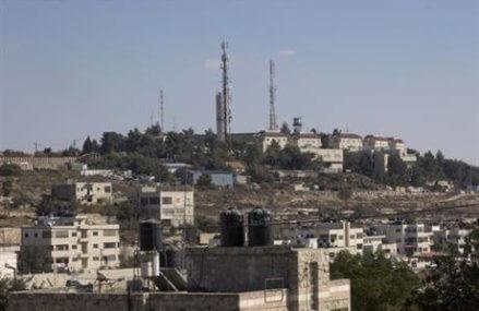 The Latest: Palestinians condemn Israeli settlement plans