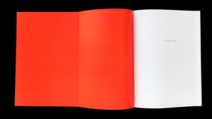 Enigmatic Stream, half title page with red flaps