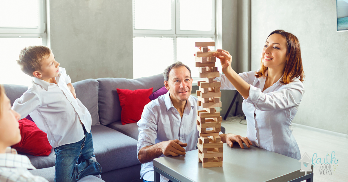 A family playing a game together to build strong family bonds.