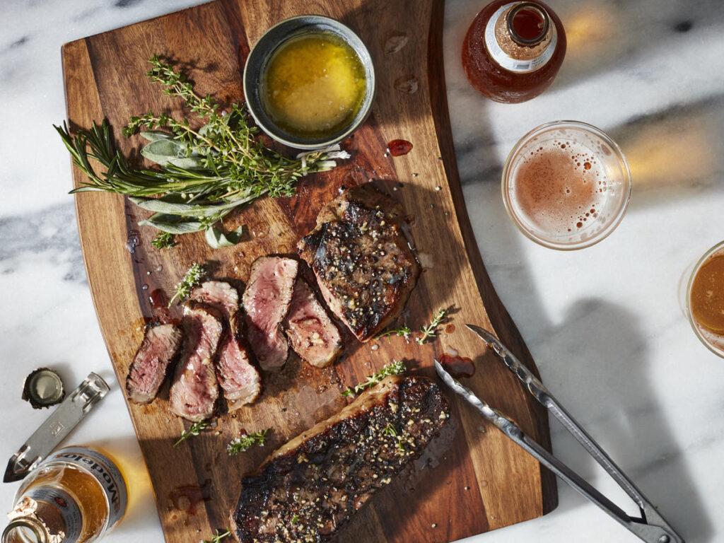 ny strip steak on cutting board