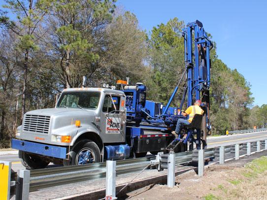 Acme Barricades Employee Installing Metal Guardrails