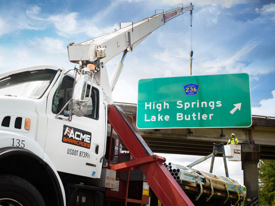 Acme Barricades installing a highway overpass permanent sign