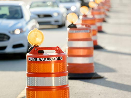 Acme Barricades orange barrels used as temporary traffic control in Jacksonville