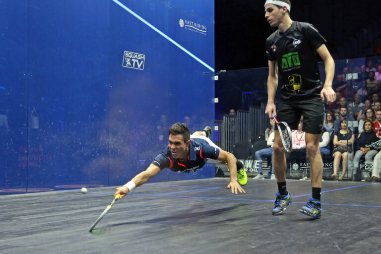 Miguel Rodriguez dives for a shot against Ali Farag during the 2018 British Open