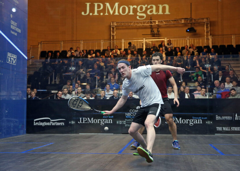 Todd Harrity (left) of the United States takes on Tsz Fung Yip (right) during the 2019 J.P. Morgan Tournament of Champions