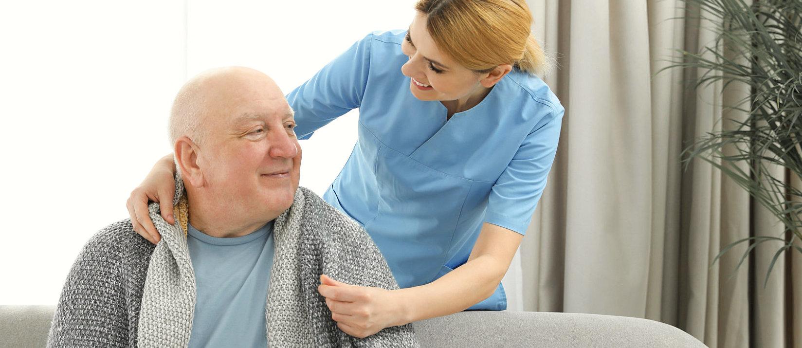 senior man talking with his caregiver