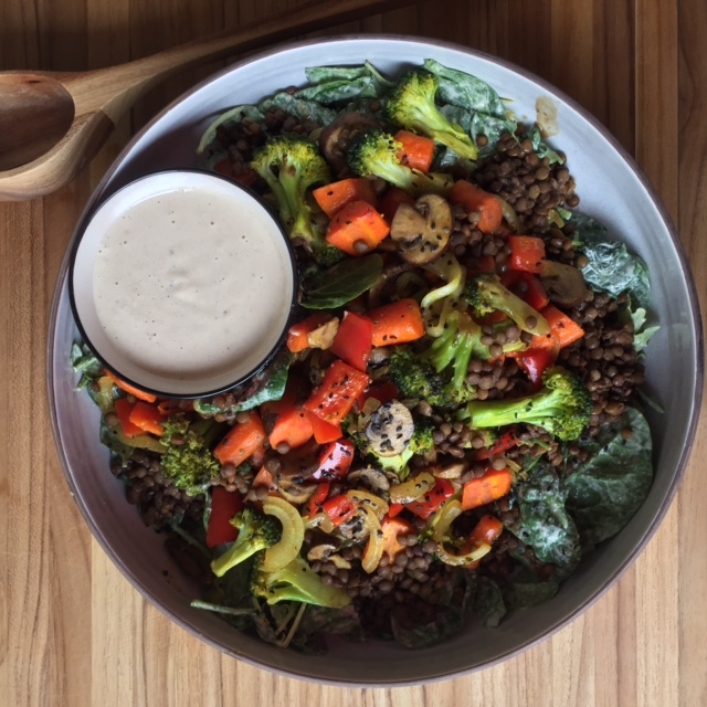 Red Wine Lentils with Curried Roasted Spring Vegetables on Baby Kale with Tahini Garlic Dressing