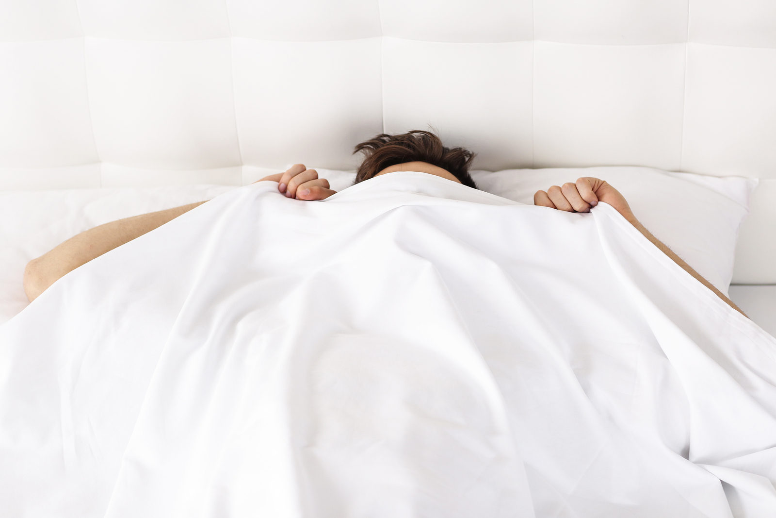 Morning concept. Man under covering in bed.