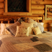 Lakeside-Living_Manitowish-Waters_Northwoods-WI_Bedding-Basics_Log-Cabin-Bedroom_Patchwork-Quilt_Various-Decorative-Pillows