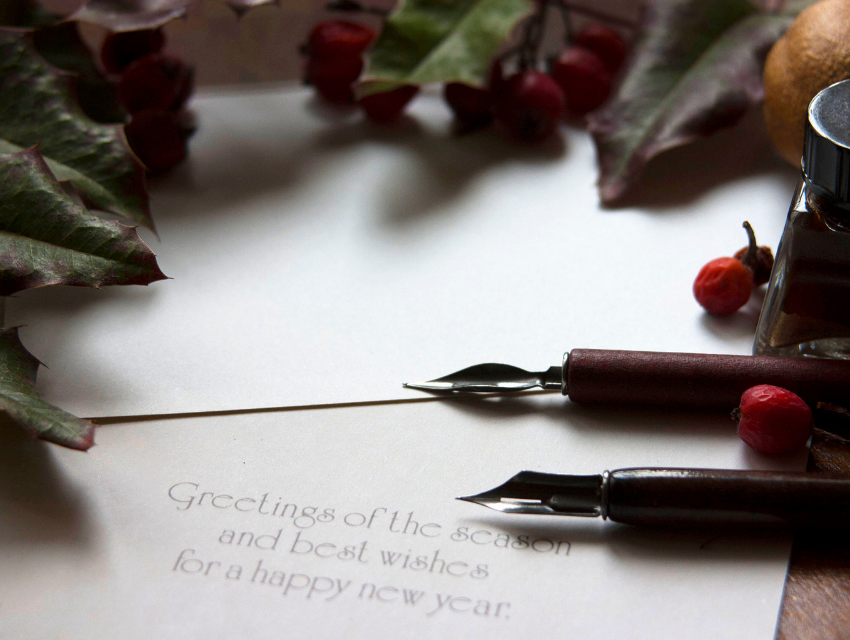 Lakeside-Living_Manitowish-Waters-WI_How-to-Show-Your-Loved-Ones-You-Care-This-Holiday-Season_Pen-and-Ink-Near-Holiday-Card