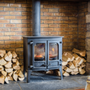 Manitowish Waters WI antique wood burning stove surrounded by stacks of wood