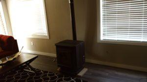 Monkey Island Gray Cabin - Wood stove in livingroom