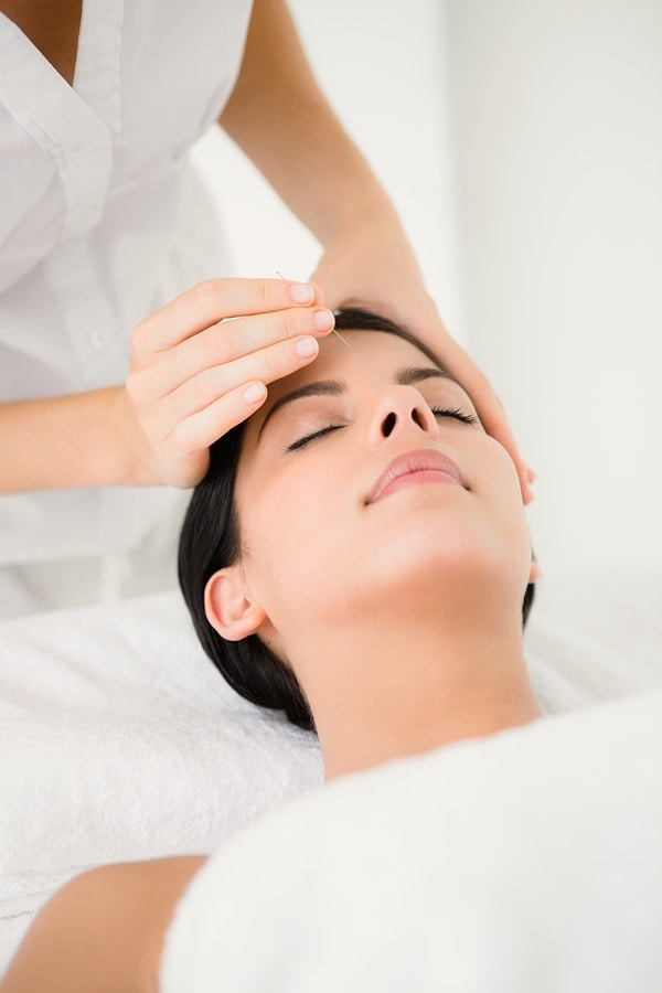 bigstock-Woman-in-an-acupuncture-therap-99138557