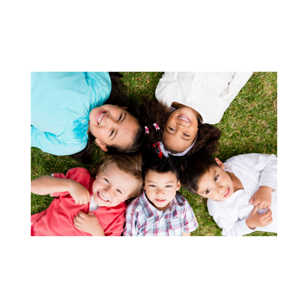 five children looking up to camera smiling