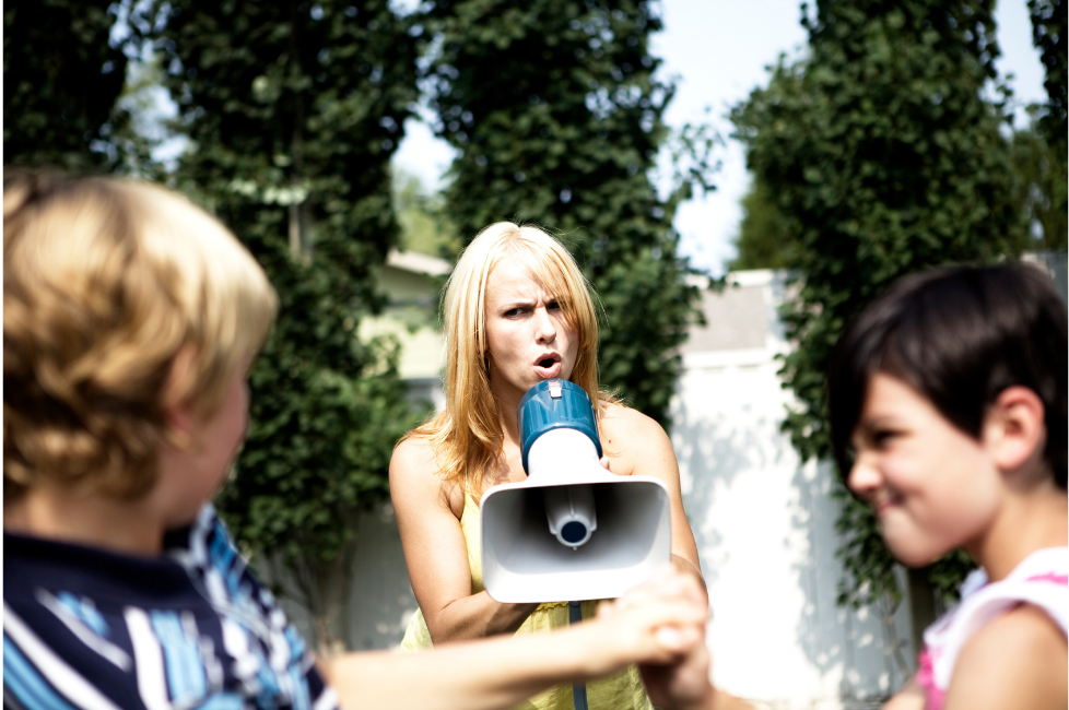 Frustrated mother screaming yelling megaphone