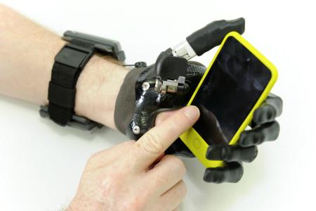 Holding a smartphone using  i-limb Digits