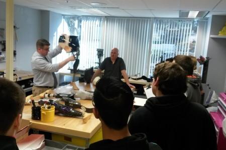 Teacher demonstrating use of prosthetic technology
